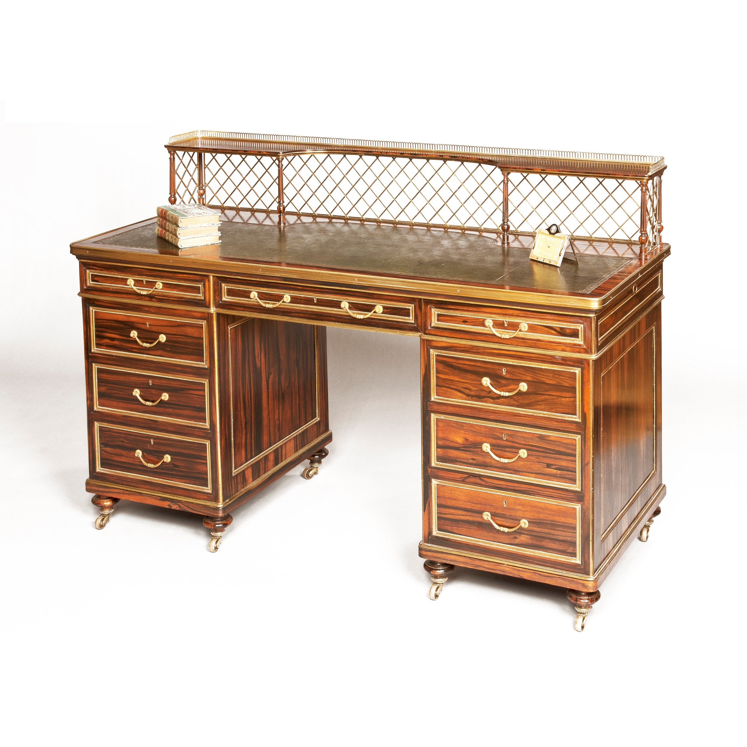A Very Fine Writing Desk, firmly attributed to Wright & Mansfield, circa 1860. Butchoff Antiques, London.